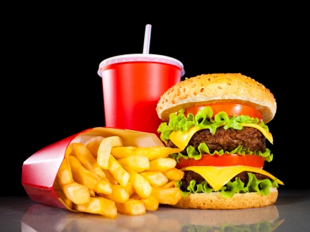 fast meal: Tasty hamburger and french fries on a dark background