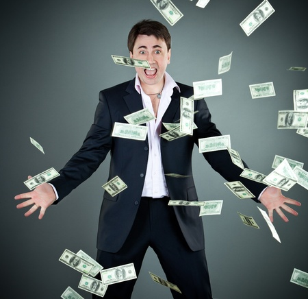 man in a suit throws money photo