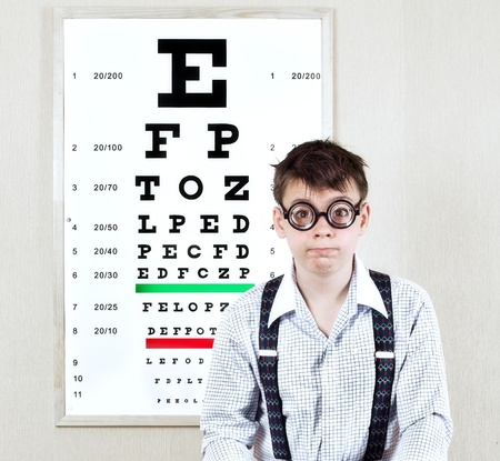 blind people: person wearing spectacles in an office at the doctor