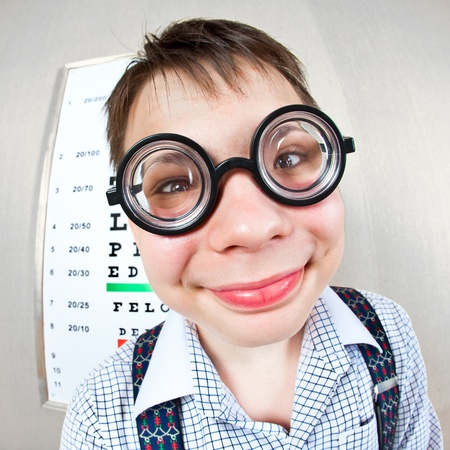 diopter: person wearing spectacles in an office at the doctor