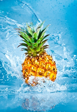 Fresh pineapple in water splashes Stock Photo