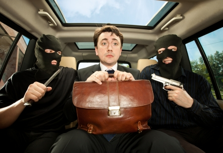 Robbery, businessman grasped in hostages. Stock Photo - 10115585