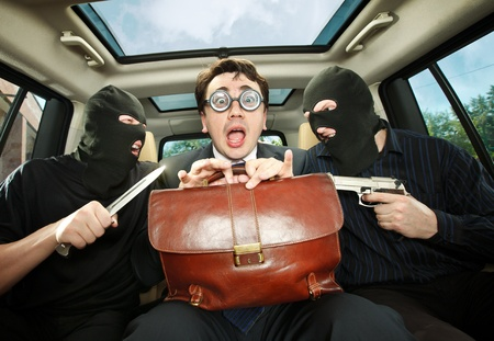Robbery, businessman grasped in hostages. Stock Photo - 10115584