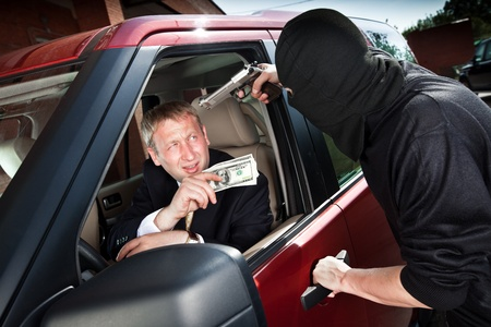 robberies: Robbery of the businessman in its car Stock Photo
