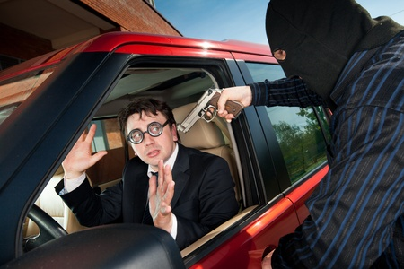 Robbery of the businessman in its car Stock Photo