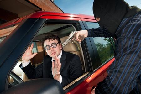 burglar man: Robbery of the businessman in its car Stock Photo