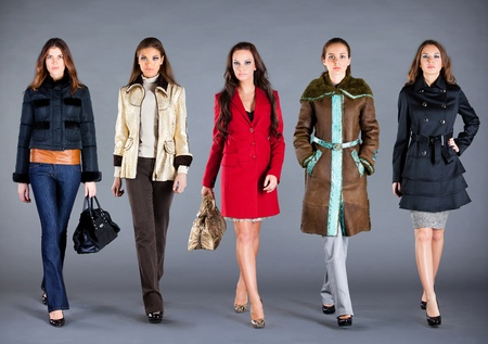 topcoat: Five girls in different clothes, autumn winter collection clothes Stock Photo