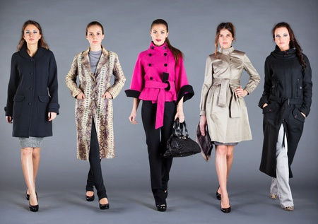 handbags: Five girls in different clothes, autumn winter collection clothes Stock Photo