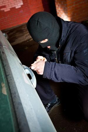 criminal activity: robber and the thief hijacks the car Stock Photo
