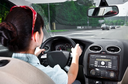 car driving: women at the wheel the car ...