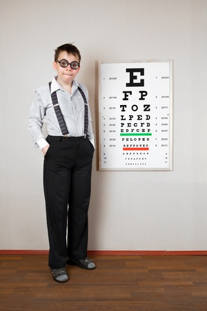 blind child: person wearing spectacles in an office at the doctor