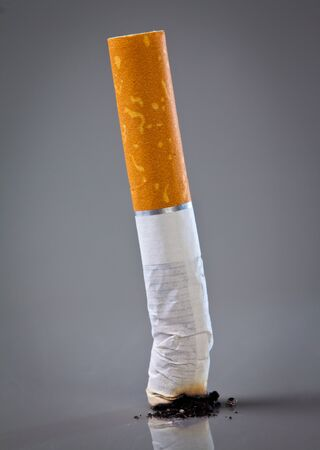 ende: cigarette end on a grey background Stock Photo