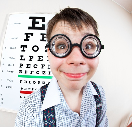 types of glasses: person wearing spectacles in an office at the doctor