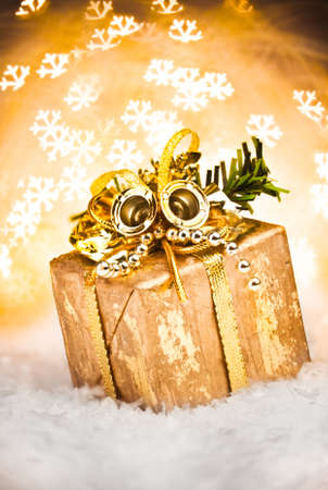 Christmas gift with Golden Holiday Background. photo