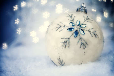 Christmas ball with Blue Holiday Background. photo