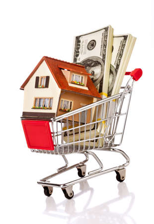 car loans: shopping cart and house on a white background