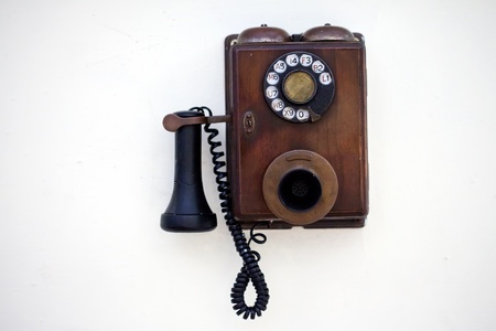 ancient telephone: Retro phone on a white wall