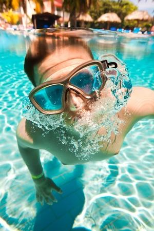 teenager floatsunder water in pool Stock Photo - 11986444