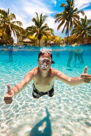 teenager floatsunder water in pool Stock Photo - 11986471
