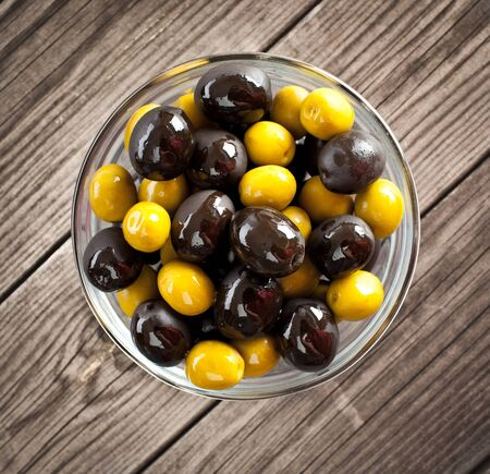 Olives on a wooden table ... photo
