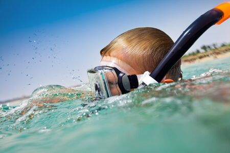 subaquatic: boy floats in the sea
