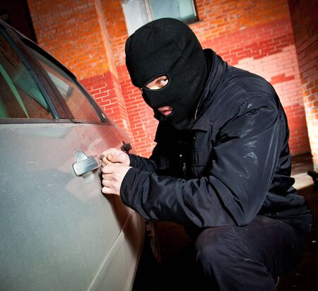 looting: robber and the thief hijacks the car Stock Photo