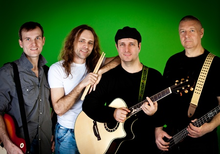 Musical group of artists on a green background photo