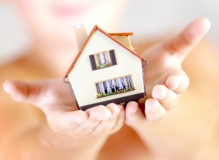 new build: The house in human hands Stock Photo