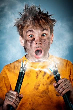 Electric shock sees a shocked boy Stock Photo - 12938706