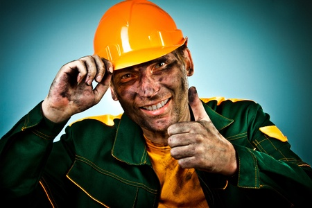 face work: oil industry worker on blue background
