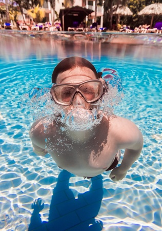 teenager floatsunder water in pool Stock Photo - 13133919