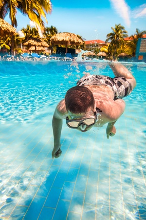 teenager floatsunder water in pool Stock Photo - 13173317