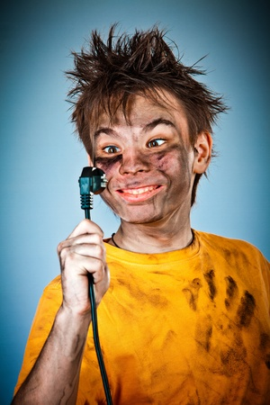 Boy has a electric shock Stock Photo - 13109656