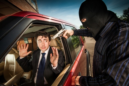 Robbery of the businessman in its car photo