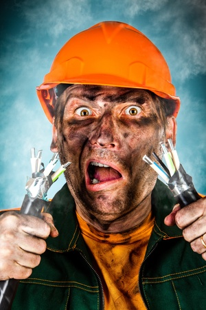 energy work: Electric shock sees a shocked electrician man