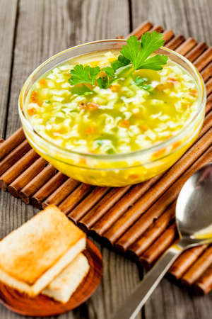 chicken noodle: noodle soup on a wooden table Stock Photo