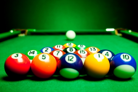 Fifteen billiard spheres lay on green cloth Stock Photo