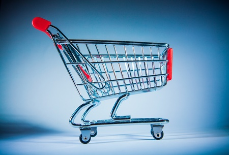 shopping trolley: shopping cart on blue background