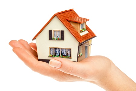 house in human hands on a white background photo