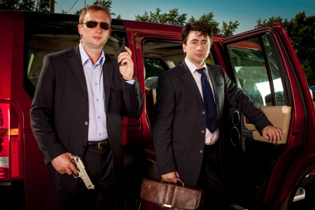 bodyguard and its boss leave the car Stock Photo - 14132023