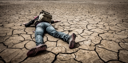 traveller lays on the dried ground photo