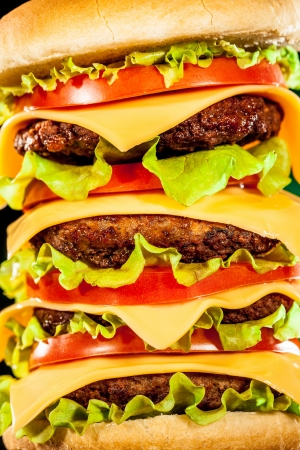 Tasty and appetizing hamburger on a dark background photo