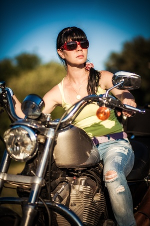 Biker girl sits on a motorcycle Stock Photo - 14736638