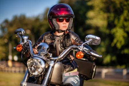 biker girl: Biker girl sits on a motorcycle
