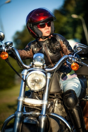 Biker girl sits on a motorcycle Stock Photo - 14736639