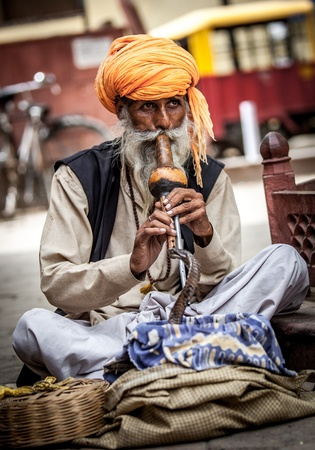 poverty in india: Photo street snake charmer. India. Stock Photo