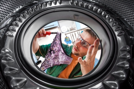 Repair of washing machine. A man found a women's panties photo