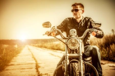 motorcyclist: Biker man sits on a bike Stock Photo