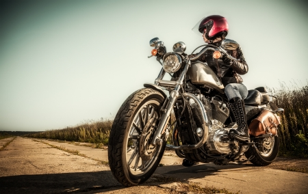 Biker girl sits on a motorcycle Stock Photo - 15388411