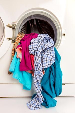 Washing machine with clean linen photo
